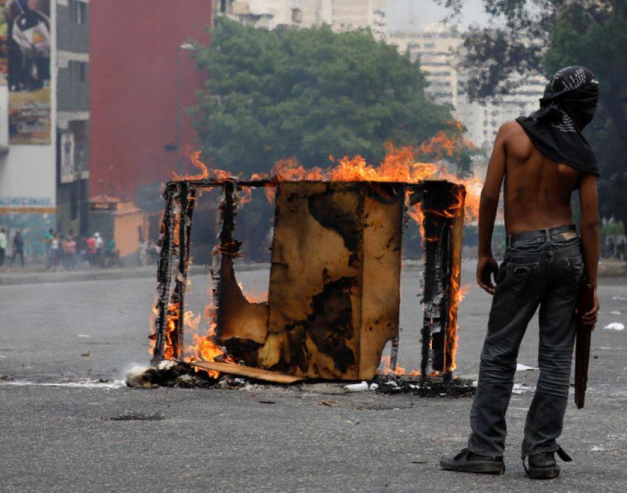 Venezuelans set up burning barricades over lack of power, water