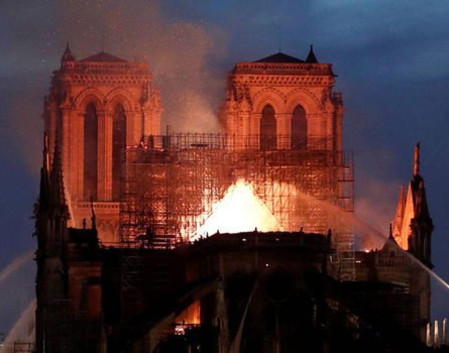 Exact moment Notre Dame Paris spire fell