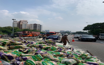 Lorry laden with rice, noodles overturns on highway