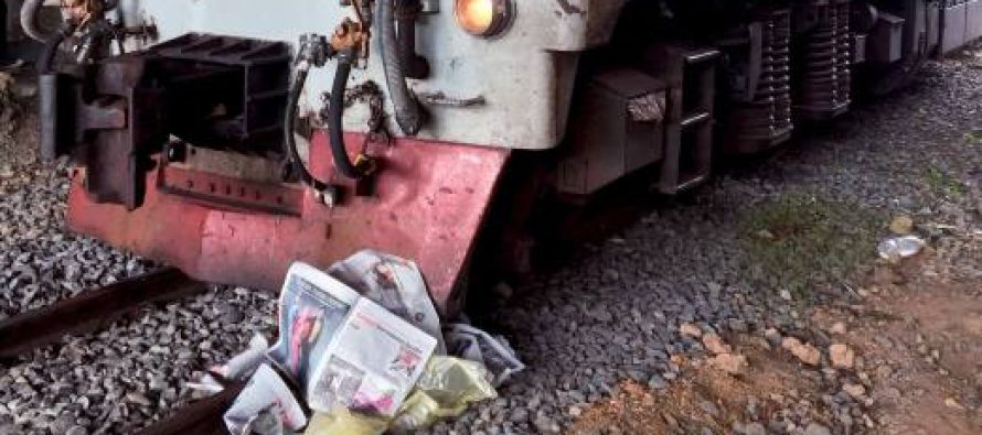 Trailer carrying scrap rubber overturns on railway track