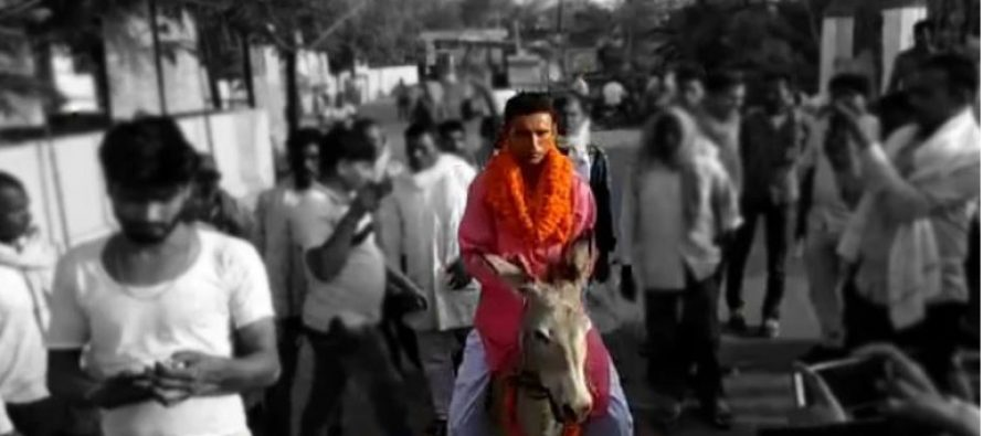 India politician charged after donkey ride to file papers