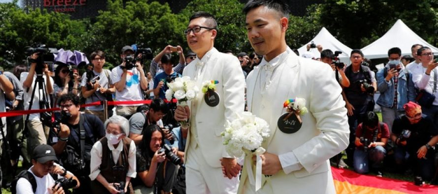 Taiwan celebrates same-sex marriages as first country in Asia to legalise them