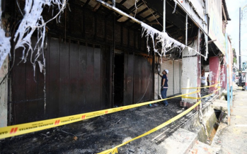 Seven foreign workers escape unhurt in shophouse fire
