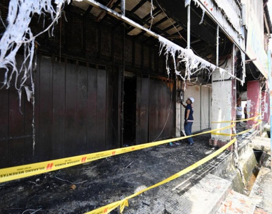 Seven foreign workers escape unhurt in shophouse fire