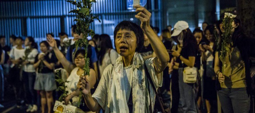 Hong Kong protesters begin night vigil as extradition anger mounts