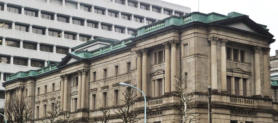 Bank of Japan hints at more easing if inflation sputters, keeps policy steady