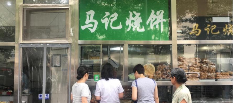 Beijing orders Arabic, Muslim symbols taken down from food outlets