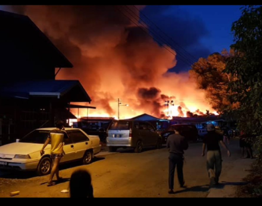Man dies in fire which destroys 29 houses