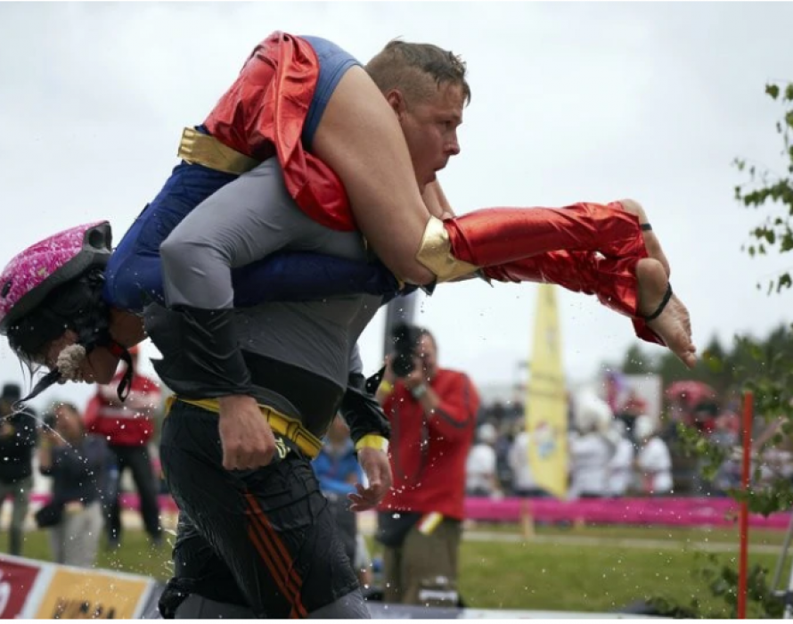 Couple wins 'wife carrying' championship, gets wife's weight in beer as prize