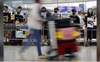 Protesters throng Hong Kong airport, property lobby calls for calm