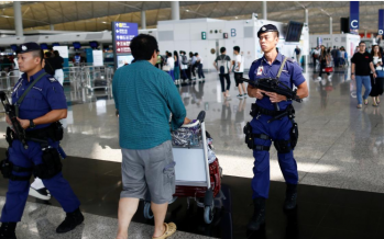 Hong Kong airport operating as usual, for now