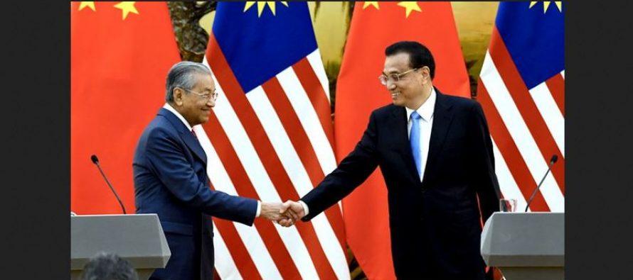 Under Mahathir, Malaysia makes bold move to embrace China