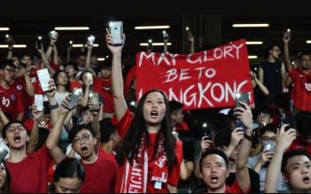 Hong Kong protesters sing and boo China anthem