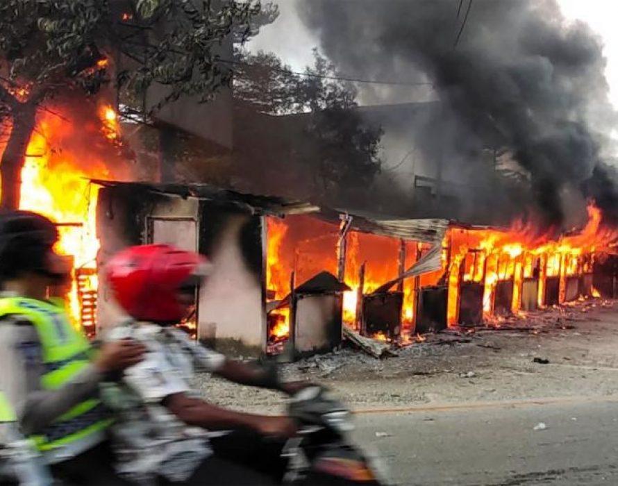 Dozens arrested for Papua protests that set buildings afire