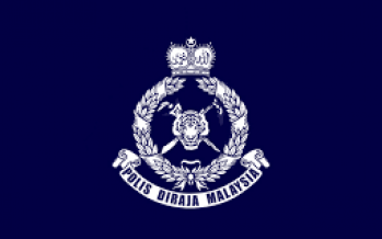 Three arrested after body found in condo guardhouse toilet
