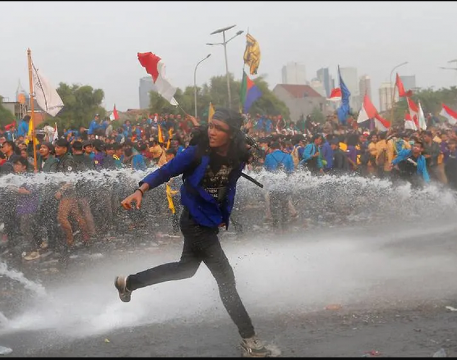Police fire water cannon as Indonesians rally against new laws