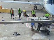 Viral video: Catering cart out of control, almost hits plane