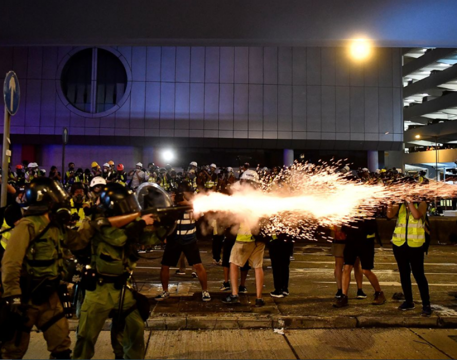 HK protesters and police clash, metro and shops targeted