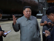 North Korea warns it may end freeze on missile testing