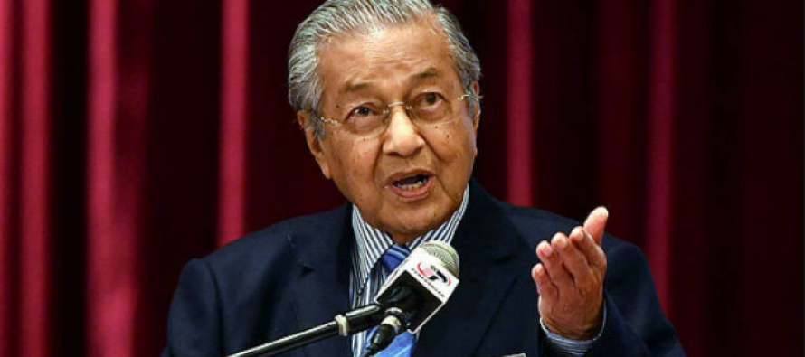 Dr M tells urban poor to start small business