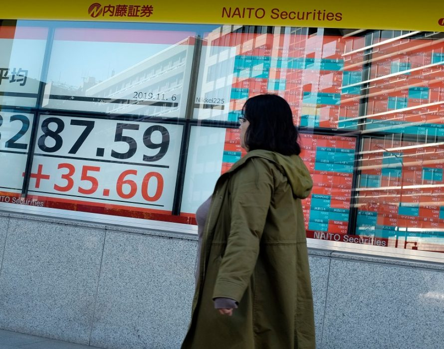 Asian shares waver as Hong Kong tensions spoil the festive mood