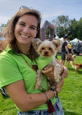 Lindsay Saggu and Bella, canine customer, at Pet-A-Palooza Victoria 2019 with new brand colours