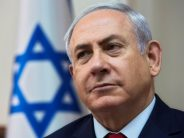 Embattled Netanyahu charged for corruption, won't quit as PM