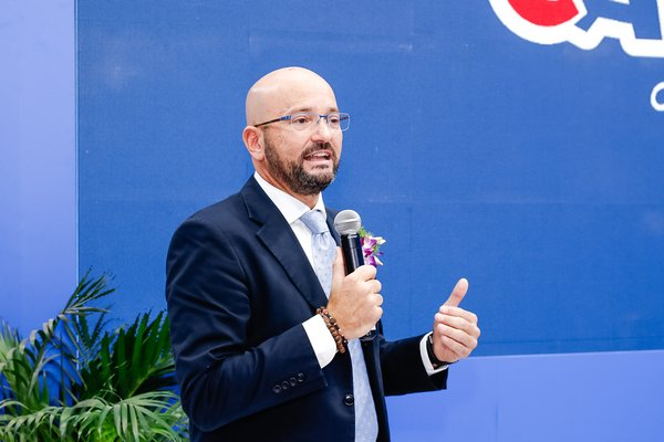 CARIOCA CEO Enrico Toledo delivers a speech