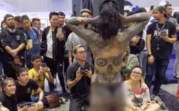 Malaysia orders inquiry over half-naked tattoo show