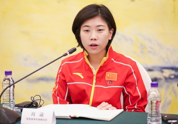 """Ms. Xiao Han, former winner of the Short-track Speed Skating World Championship speaking at the MOU signing ceremony of """"Olympics and Women"""" program"""