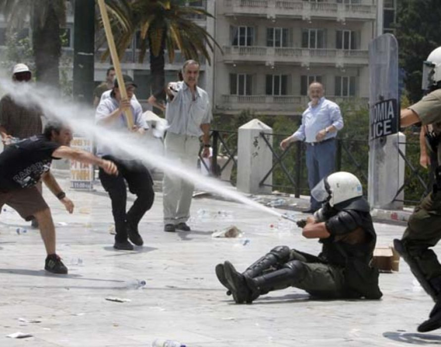 Police detained about 80 people during violent riots across greece