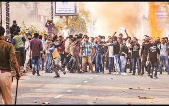 Three die in protests against new citizenship law in India