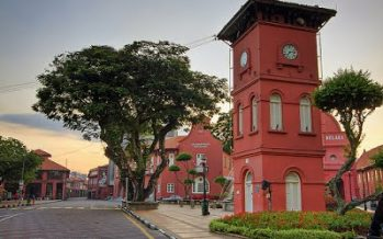 Melaka's iconic red clock tower continues to draw tourists