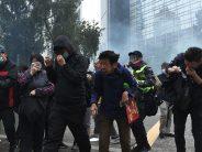 Police arrest organiser of Hong Kong protest after rally turns violent