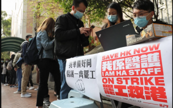 Coronavirus: HK reports first death as hospital workers escalate strike