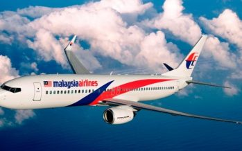 Malaysia Airlines enforces the use of face masks on passengers