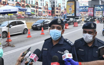 Motorist was arrested after rams into roadblock