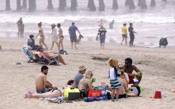 Americans pass pandemic holiday on beaches, in parks as death toll nears 100,000