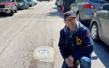 Chicago artist fills potholes with coronavirus-themed art
