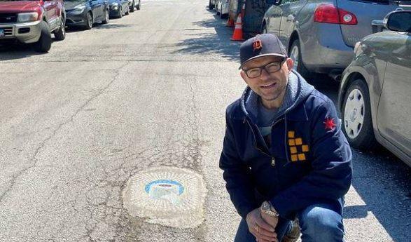 Chicago artist fills potholes with coronavirus-themed art