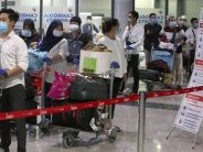 Stranded Cambodians home on special flight: 212 return from locked-down Malaysia