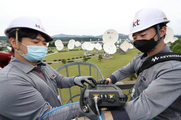 KT SAT engineers check a satellite antenna at the Kumsan Satellite Service Center.