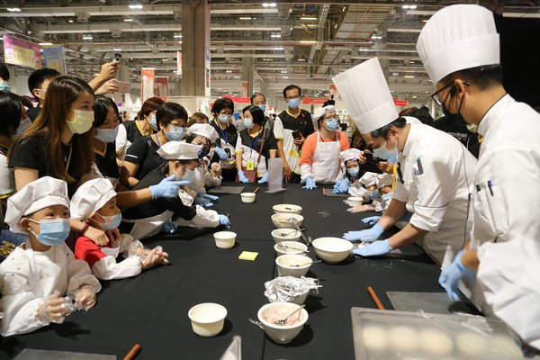 Children learn how to prepare food in the Luso International (LIB) Presents: Little Master Chef Workshop and play games at booths at the Sands Shopping Carnival at The Venetian Macao's Cotai Expo.
