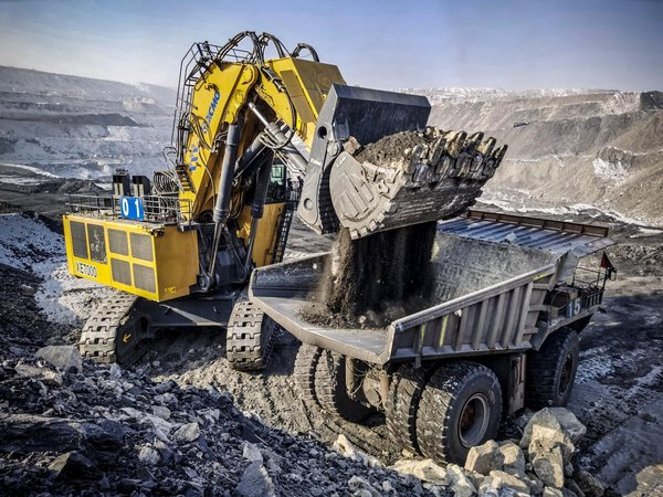XCMG XE70000, the largest tonnage hydraulic excavator is in use at a construction site in Inner Mongolia, China