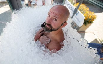Austrian man spends 2.5 hours in box filled with ice cubes to break record