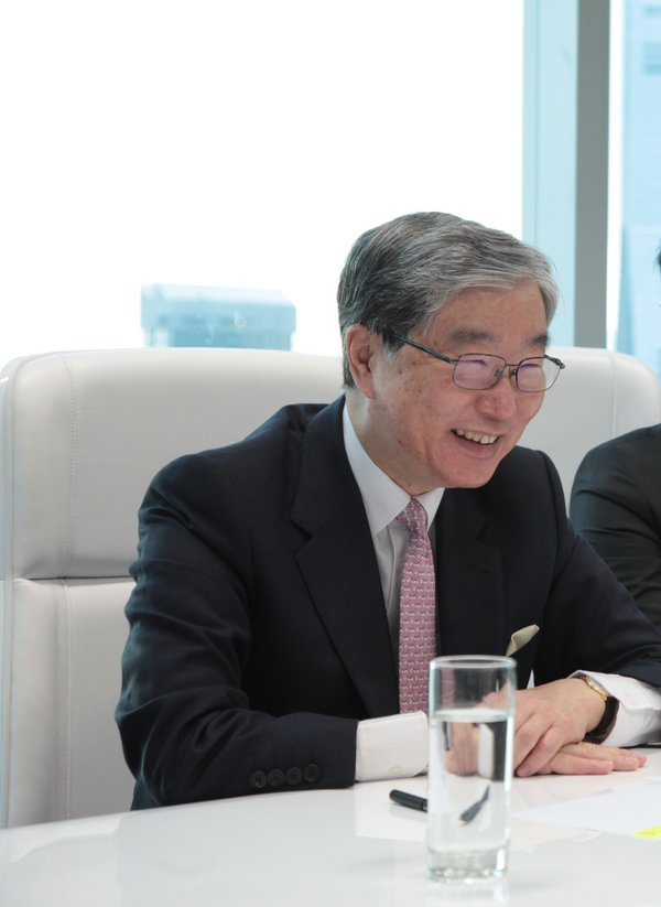 Bank of Asia Founder Carson Wen delivers a speech