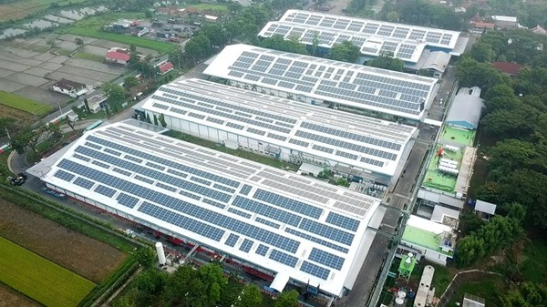 Solar panels installed on rooftops of Danone's Klaten factory, system developed, built and operated by Total Solar DG