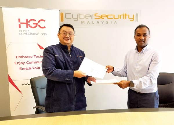 HGC signs MoU with CyberSecurity Malaysia cementing national telecoms cybersecurity. (From Left to Right: Dato' Ts. Dr. Haji Amirudin Bin Abdul Wahab, CyberSecuity Malaysia's Chief Executive Officer and Ravindran Mahalingam, HGC's SVP of International Business)