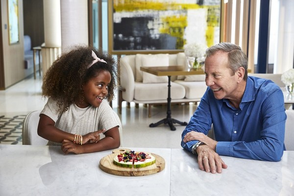 Jumeirah FoodieKiDS - Chief Culinary Officer Michael Ellis with one of the little foodies who helped shape the menu