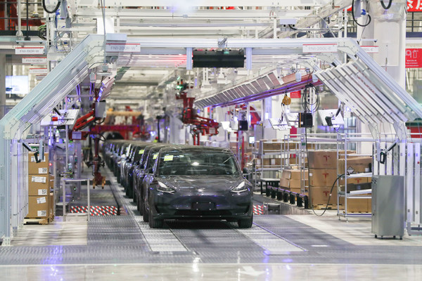 Electric cars roll off the production line at a Tesla plant in Shanghai